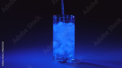 Glass of pure water with ice cubes.
