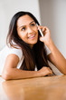 Closeup portrait of attractive young teenage girl talking mobile