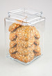 jar filled with cookie covered with seeds with clipping path