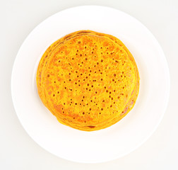 pancakes in a plate on white background