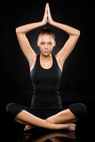 Young woman performing yoga with raised hands