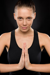Portrait of smiling young woman performing yoga
