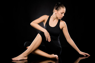 Attractive young woman in spine twisting pose