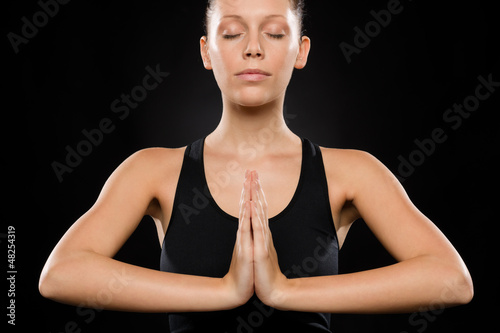Portrait of young Caucasian woman exercising yoga