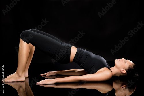 Woman doing stretching exercise on the floor