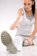 Young woman doing exercises on white background