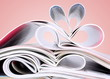 Romantic heart of magazines on a red background