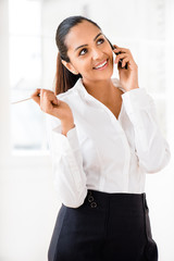 Indian business woman using mobile phone
