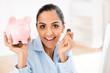 Indian business woman saving money piggy bank