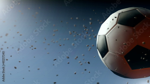 Computer generated soccer ball in slow motion (with particles)