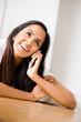Pretty portrait Indian teenager using mobole phone
