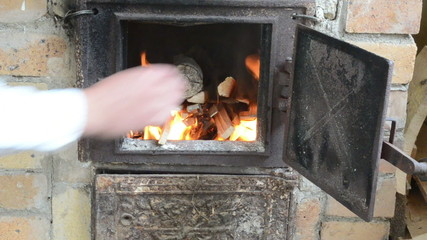 fast hands fire newspaper paper firewood match old rural stove