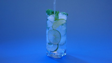 Mojito cocktail on blue background