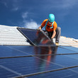 canvas print picture - Man installing solar panels