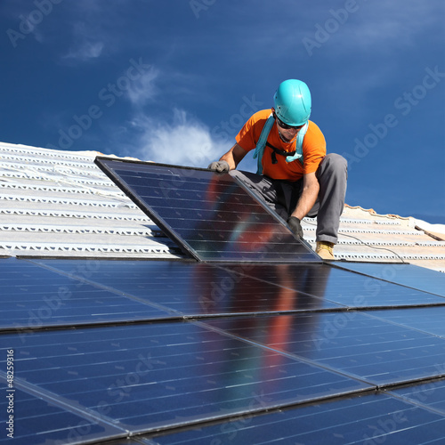 canvas print picture Man installing solar panels