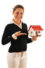 Real estate broker holding small house isolated on white