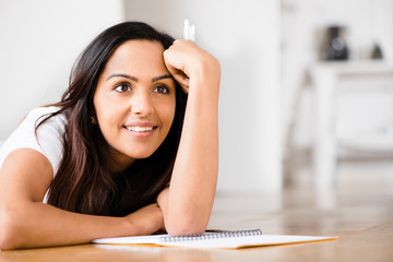 Happy Indian woman student education writing studying