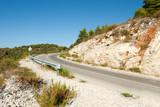 winding road in deserted landscape poster