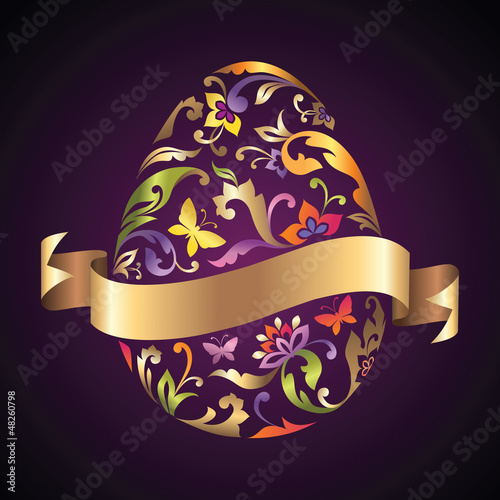 decorative Easter egg with ornate pattern and golden ribbon