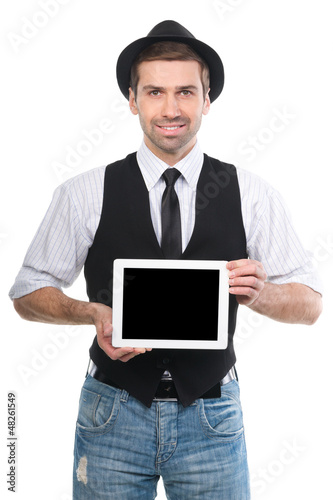 Handsome cheerfull man showing a digital tablet over a white bac