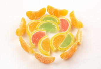 Pile tangerine and marmalade slices on a white background