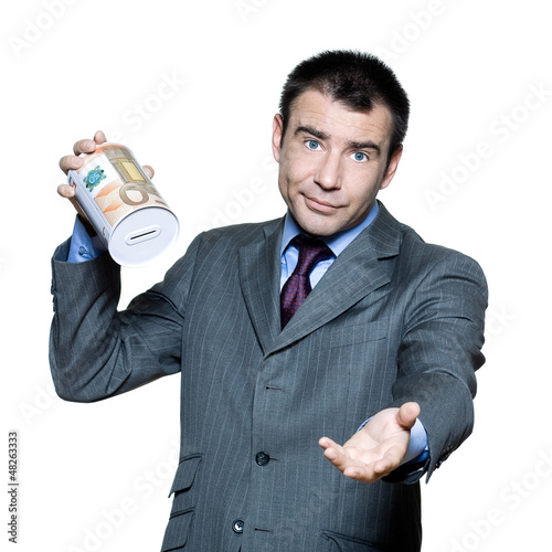 Portrait of sad businessman holding empty money box