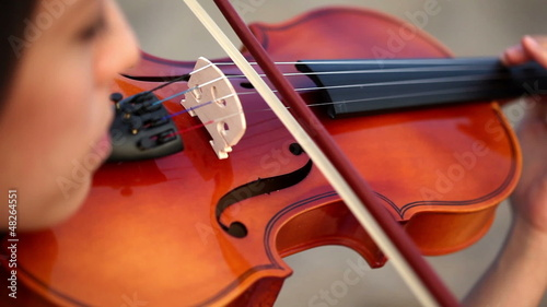 girl playing the violin in extremely close up shot