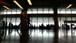 airport's hall with crowd of people in time lapse shot