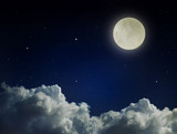 Dark cloudy blue sky with moon and stars