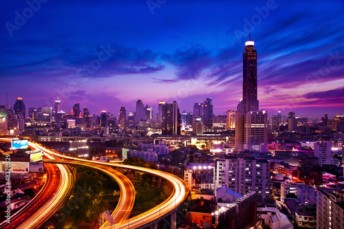 Traffic in modern city at night, Bangkok Thailand