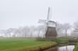 Dutch windmill in fog