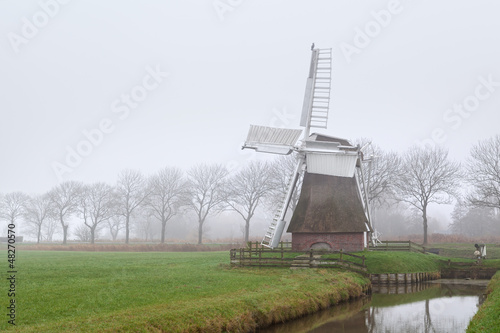 Dutch windmill in fog