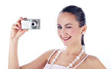 Young women holding photo camera, isolated on white