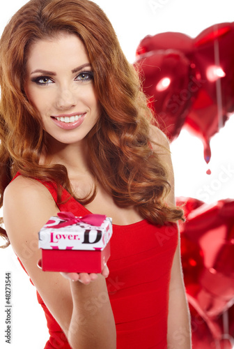 Happy young woman holding gift