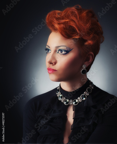 Glamour portrait of a young women, studio shot