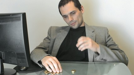 businessman makes columns of coins