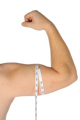 man arm with tape measure around biceps over white background