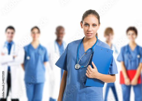 Nurse in front of her team