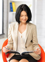 businesswoman with magazine