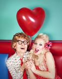 Happy nerdy couple celebrating valentine's day