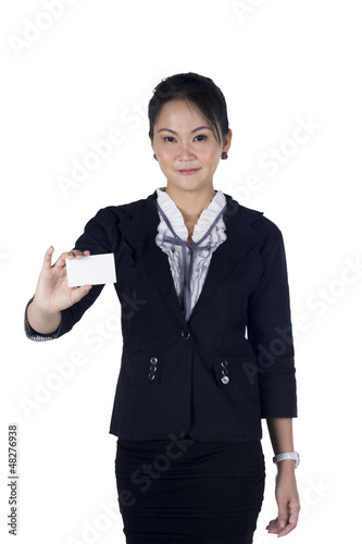 Business woman in black suit handing a blank business card
