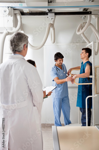 Medical Team With Patient In X-ray Room