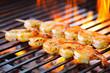 Leinwandbild Motiv prawn spit on grill
