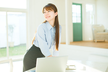 Beautiful asian businesswoman using a laptop computer