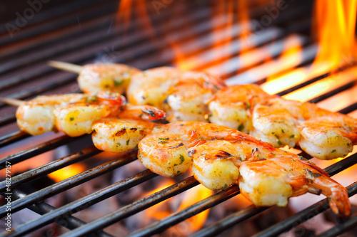 Plexiglas Schaaldieren prawn spit on grill