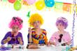 Children happy birthday party eating chocolate cake