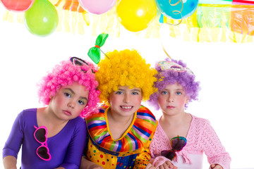 Children happy birthday party with clown wigs
