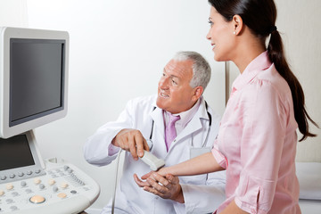 Radiologist Scanning Female Patient's Hand
