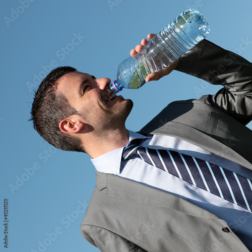 handsome businessman drinking water