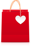 Red paper shopping bag with white paper heart label